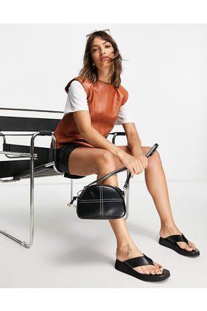 Muubaa Power shoulder leather sleeveless top in brown