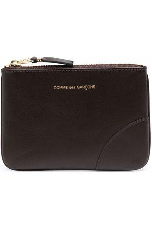 Comme Des Garçons Wallet Debossed-logo leather pouch