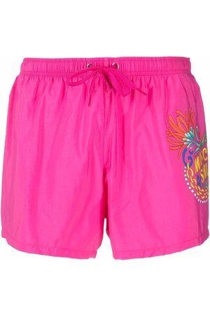 Moschino Graphic-print swim shorts