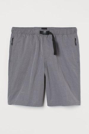 H&M Heren Shorts - Short met riem