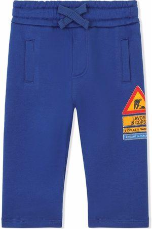 Dolce & Gabbana Road sign-print track pants