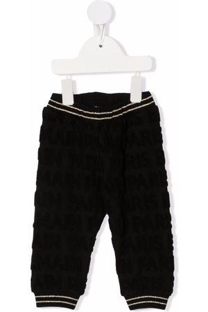 Balmain Chino's - All-over monogram trousers