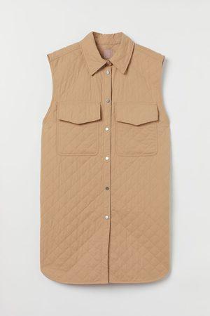 H&M + Mouwloze hemdjas
