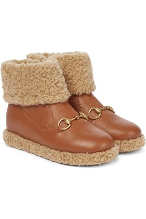 Gucci Faux-fur lined leather ankle boots