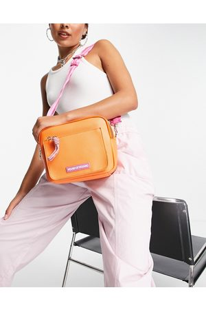House Of Holland Cross body camera bag in orange with contrast logo strap in pink