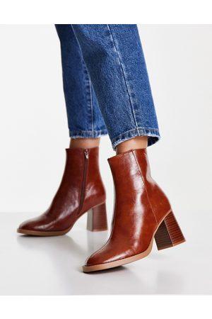 ASOS Revival round toe block heeled boots in tan-Brown