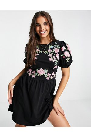 ASOS Mini dress with puff sleeve and cross stitch embroidery in black