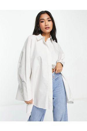 ASOS Oversized cotton shirt in stone & white stripe