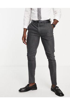 ASOS Wedding skinny wool mix suit trousers in charcoal herringbone-Grey