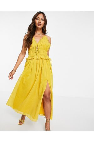 ASOS Strappy textured spot detail midi dress with ruched waist in yellow