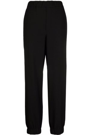 Ganni Heavy-crepe elasticated-ankle trousers