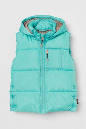 H&M Gewatteerde bodywarmer met kap THERMOLITE® - Turquoise