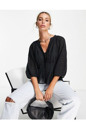French Connection Cora wrap top with waistband detail and sheet sleeves in black