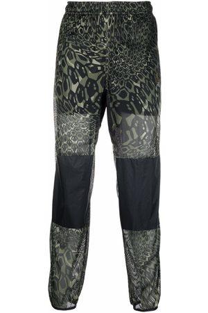 "Nike Dri-FIT ACG ""happy arachnid"" pants"