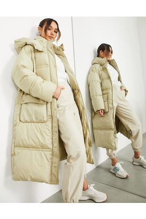 ASOS Longline puffer jacket with pockets in camel-Green