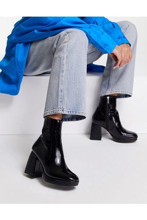 ASOS Era high-heeled platforms boots in black croc