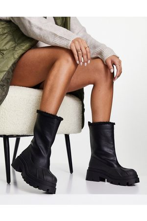 ASOS Alice shearling lined pull on boots in black